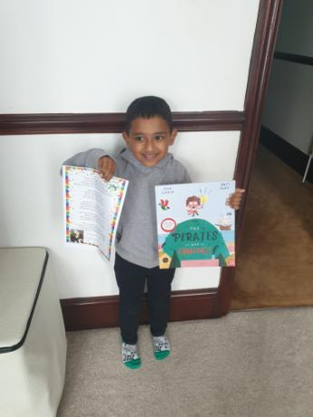 Yusuf with his book